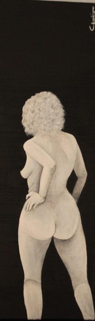 Femme nue sur fond noir